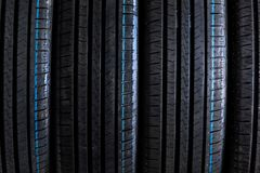 Stack of brand new high performance car tires Royalty Free Stock Image