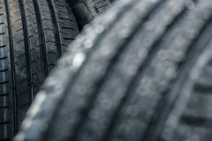 Stack of brand new high performance car tires Stock Photo