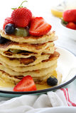 Stack of breakfast pancakes with fruits and sauce Stock Photo