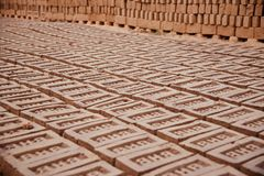 Stack of bricks in a brick field unique photo. Bricks surface around a bricks field isolated unique photo royalty free stock images