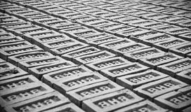 Stack of bricks in a brick field unique photo. Bricks surface around a bricks field isolated unique photo stock photography