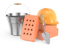 Stack of bricks, trowel and helmet Stock Image