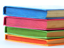 Stack of bright books over white Royalty Free Stock Photography