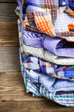 Stack of bright colorful shirts Royalty Free Stock Photo