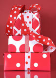 Stack of bright modern red and white polka dot and check gift boxes Stock Images