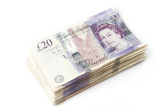Stack of British Pounds. On white Stock Photo