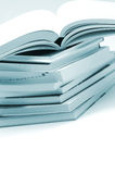Stack of brochures. On white in blue toned Stock Photography