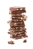 Stack of broken chocolate isolated. Stack of broken chocolate with nuts isolated Stock Photos