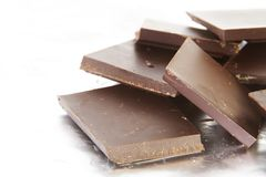 Stack of Broken Dark Chocolate Pieces Stock Images