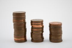 Stack of bronze coins on white background. Coins of five euro cents stock photo