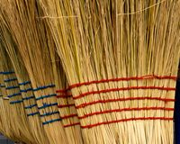 Stack of Brooms Stock Photo
