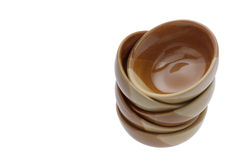 Stack of brown bowls isolated on white .clipping path. Stock Images