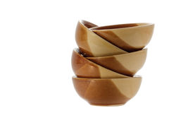 Stack of brown bowls isolated on white .clipping path. Stock Photo