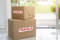Stack of brown cardboard boxes, fragile box, Fast and reliable service. Delivery and packing concept. S royalty free stock photo
