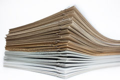 Stack of brown and white paper. On white background Stock Photos
