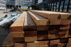 Stack of woorden beams ready to be used for construction work royalty free stock images