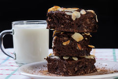 Stack of brownies on white plate Royalty Free Stock Image