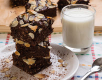 Stack of brownies on white plate Stock Photography