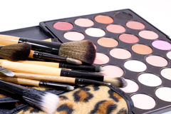 Stack of brushes with creamy eye shadows for make up Stock Image