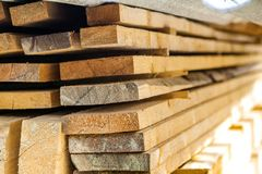 Stack of building lumber at construction site with narrow depth Royalty Free Stock Photos