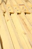 Stack of Building Lumber at Construction Site Stock Photos
