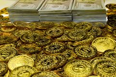 Stack bundles of 100 US dollars and gold coins banknotes royalty free stock photo