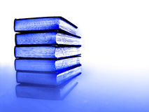 Stack of Business Books. Stack of blue business books on reflective surface with white background stock photos