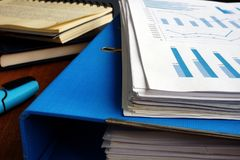 Stack of business papers and folder. Office desk with pile of documents stock image
