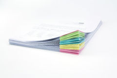 Stack of business papers. Isolated with white Royalty Free Stock Photo