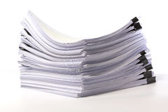 Stack of business papers on white Royalty Free Stock Images