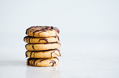 Stack of butter cookies with chocolate a white background Royalty Free Stock Images