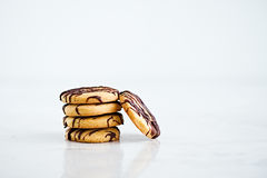 Stack of butter cookies with chocolate on a white background Royalty Free Stock Photo