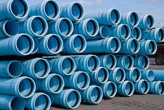 Stacks of C900 DR18 PVC Pipe. Stack of C900 DR18 PVC watermain pipe awaiting installation at a construction site Stock Photos