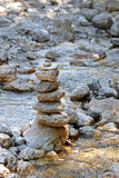 A stack of cairn stone in the stream Stock Photo