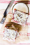 Stack of cake or cookies with plum, strawberry, raspberry and cherry jam or marmalade with sweet crumbs, cinnamon and nuts Royalty Free Stock Images