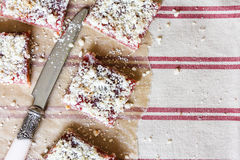 Stack of cake or cookies with plum, strawberry, raspberry and cherry jam or marmalade with sweet crumbs, cinnamon and nuts on a pa Stock Images
