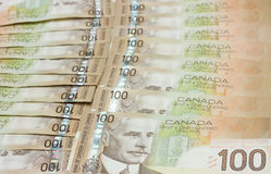 A stack of Canadian one hundred dollar bills. Canadian one hundred dollar bills in a row Stock Images