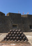 Stack of cannon balls In Castillo San Christobal. Royalty Free Stock Images