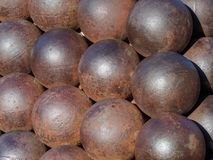 Close up cannon balls. A stack of cannon balls near the royal palace in Monaco Stock Photography