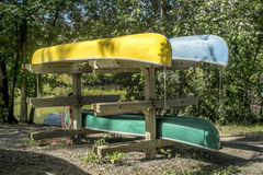 Stack of Canoes Stock Images