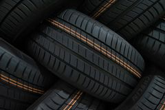 Stack of car tires with shadow deep of view. Great for backgrounds.  royalty free stock image