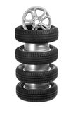 A stack of car wheels and tires. Royalty Free Stock Photography