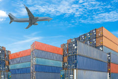 Stack of cargo containers with plane on blue sky background Stock Photography