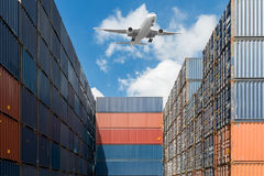 Stack of cargo containers at port terminal. Stack of cargo containers with airplane at port terminal use for import, export and logistics background stock photography