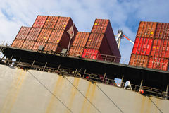 Stack of cargo freight container. On ship at harbour terminal Stock Photos