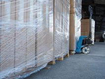 Truck loading and shipping. Stack of carton boxes on pallet ready for transport. Royalty Free Stock Photos