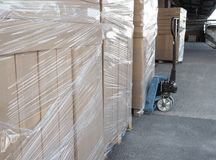 Truck loading and shipping. Stack of carton boxes on pallet ready for transport. Stock Images