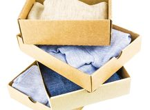 Stack of cartons with clothes. Isolated on white background Royalty Free Stock Image