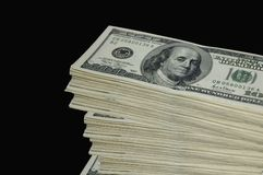 Stack of cash. A stack of cash on a black background Royalty Free Stock Images