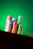 Stack of casino chips against  background Stock Photos